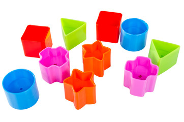 Various coloured blocks for shape sorter toy isolated