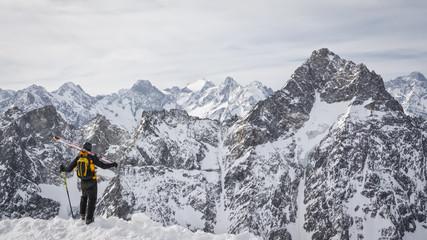 skier admiring the mountains