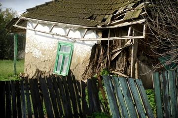 Damaged traditional adobe house