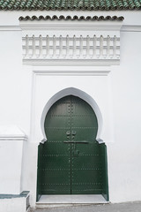 Wall Mural - Green metal gate of ancient mosque in Medina. Tangier, Morocco