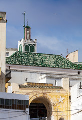 Wall Mural - Ancient mosque and roofs of Medina. Old part of Tangier town, Mo