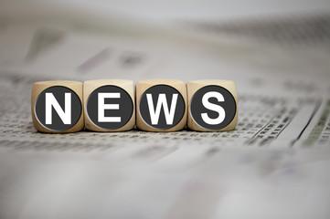 Würfel in Grau mit NEWS