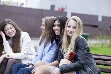 Portrait of four urban women outside