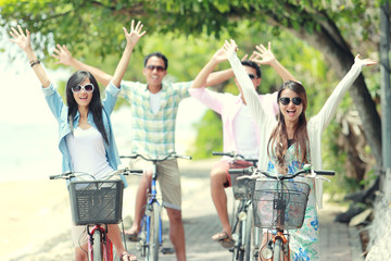 Wall Murals Cycling friends having fun riding bicycle together