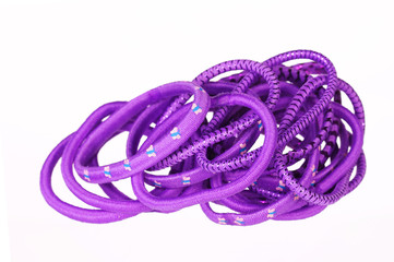 Purple hair bands isolated.