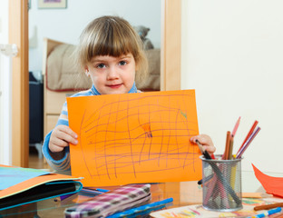 serious child with drawed paper