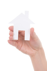 paper house in female hand isolated on white