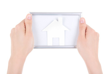 woman hand holding photo frame with paper house isolated on whit