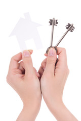 woman hands holding paper house and keys isolated on white