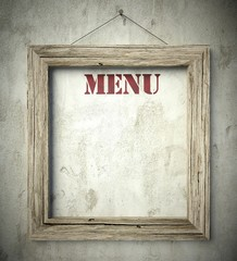 Menu in old wooden frame on wall
