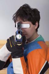 Close-up Of Man Shooting Target