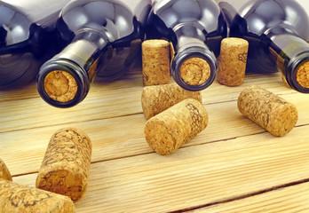 Wine bottles on background wooden slats