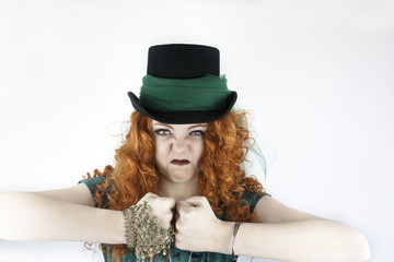 Beautiful young woman wearing top hat making a tough  face