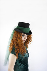 Irish woman with red hair wearing a hat