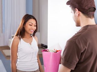 Woman Receiving Bouquet From Delivery Man