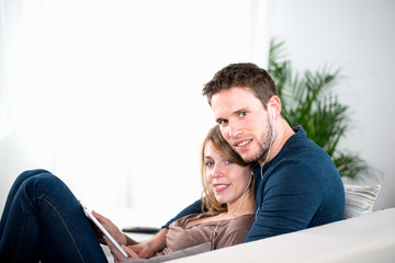 portrait of a cheerful young couple relaxed at home