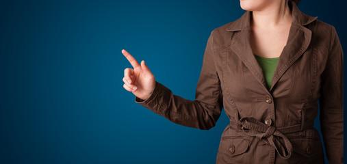 Woman pressing imaginary button