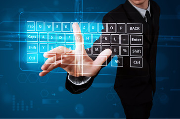 Businessman pressing virtual type of keyboard