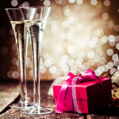 Romantic champagne with a red gift