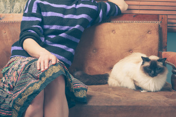 Young woman and cat on sofa