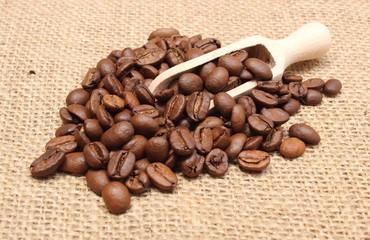 Heap of coffee on wooden spoon