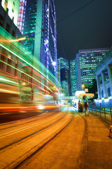 Road light trails on streetscape buildings backgrounds in HongKo