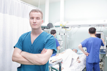 Young doctor man on a background of a hospital ward
