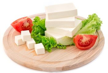 Sliced feta cheese with salad and tomato