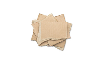 stack of ripped pieces of card board, isolated on white