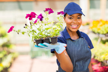african nursery worker holding flowers