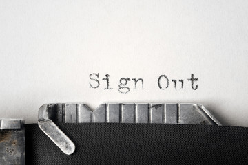 """""""Sign Out"""" written on an old typewriter"""
