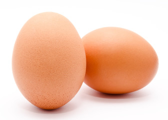 Two brown chicken eggs isolated on a white background