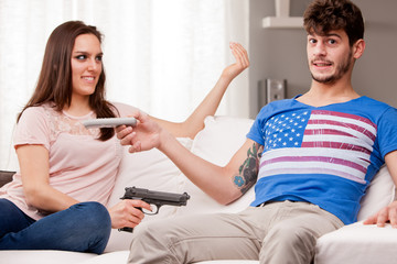 weapons: woman demanding for remote control