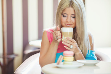 portrait of a young blonde, sitting in a cafe