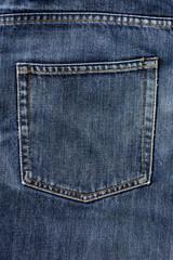 aged blue jeans pocket