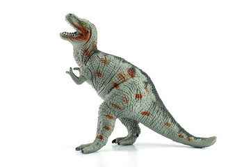 Tyrannosaurus toy isolated on white