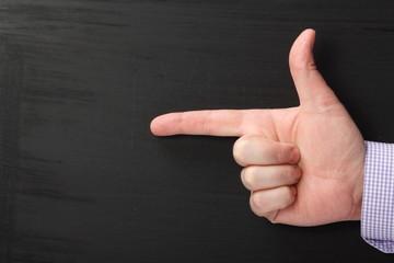 Businessman Hand Pointing on a Blackboard