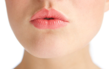 Beautiful young woman with kissing lips