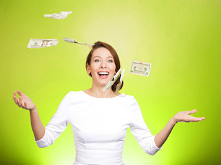 Make it rain. Woman throwing money in air on green background