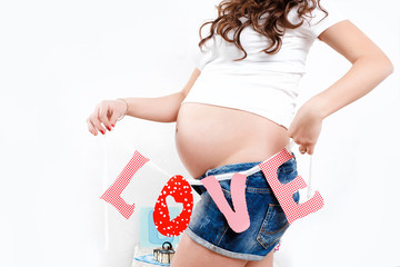 portrait of pregnant woman with word love.