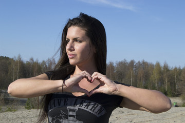 I love you - woman showing heart sign with her hands