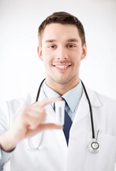 young male doctor with empty test-tube