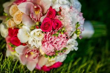 beautiful bridal bouquet of various flowers on grass