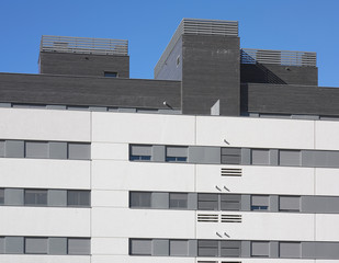 Modern building facade with blue sky