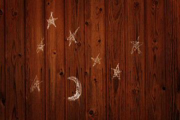 child's drawing of the moon and stars on the wall
