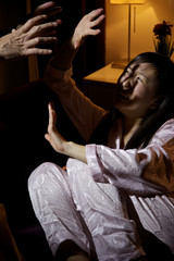 Man attacking scared asian wife