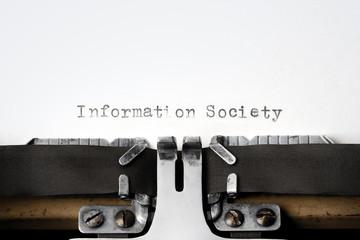 """Information Society"" written on an old typewriter"