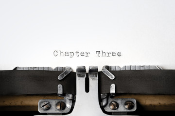 """Chapter Three"" written on an old typewriter"