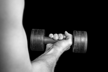 Human hand with dumbbell