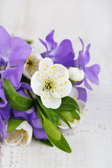 Beautiful bouquet with periwinkle flowers on wooden table